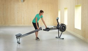 Concept 2 Model D indoor rower separating frame parts for storage.
